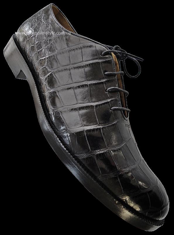 Обувь черная из цельного крокодила.